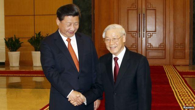 Chủ tịch Trung Quốc Tập Cận Bình và Tổng Bí thư đảng Cộng sản Việt Nam Nguyễn Phú Trọng tại Hà Nội, ngày 5 Tháng 11, 2015.