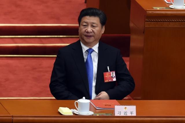 """Học giả cho rằng, người lãnh đạo Trung Quốc hiện thời đang cố gắng gọt bỏ bớt quyền lực của """"Đảng"""", tăng cường sức mạnh cho """"Chính phủ"""", rất có thể trong tương lai Trung Quốc sẽ chuyển sang thể chế Tổng thống. (AFP)"""