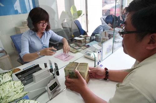 Để an toàn tiền gửi, khách hàng cần tuân thủ các quy định và giao dịch của ngân hàng. (Ảnh chỉ có tính minh họa) Ảnh: HOÀNG TRIỀU