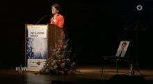 Bà dân biểu Marie-Luise Dött đọc diễn văn tôn vinh LS Nguyễn Văn Đài (ghế trống biểu tượng sự có mặt của LS Đài)