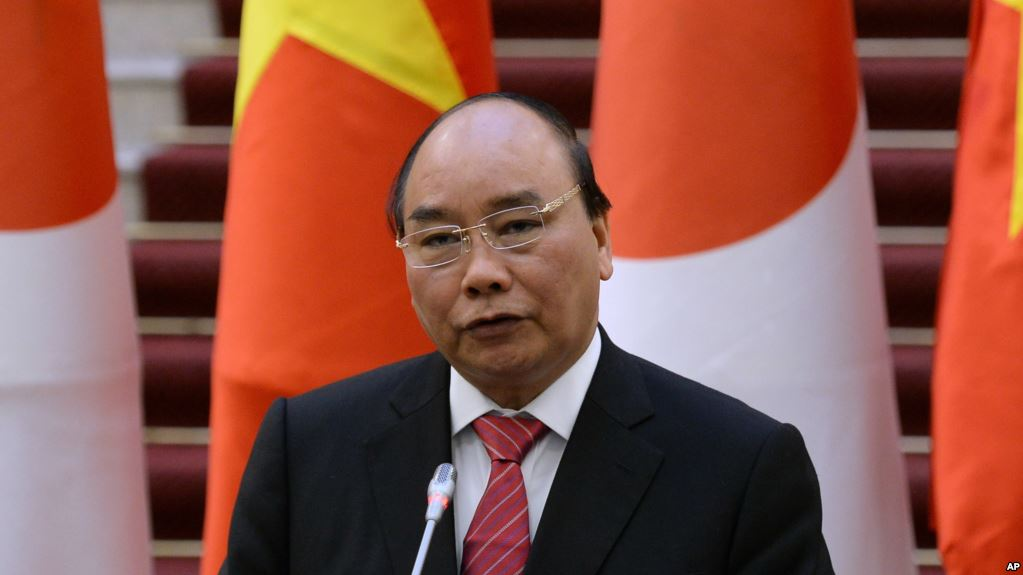 Nguyen Xuan Phuc speaks during a joint press briefing with his Japanese counterpart Shinzo Abe (not pictured) at Phuc's Cabinet Office in Hanoi on January 16, 2017.